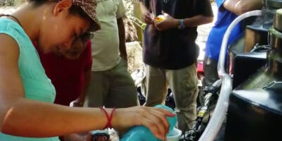 Woman using a chlorinating machine