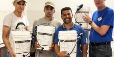 4 men holding Sawyer PointONEs