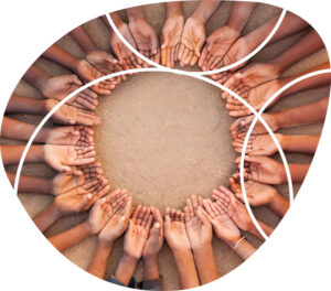 overhead shot of a number of people making a circle with their palms upturned
