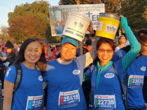 Fundraising walk photo of 3 smiling participants.